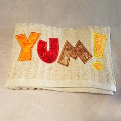 """YUM! Applique Embroidery Design INSTANT DOWNLOAD for DIY projects, from Designed by Geeks. Use any embroidery machine - Brother, Viking, Janome, Bernina, Pfaff, Singer - to stitch this design.  A great design for Thanksgiving or any food-related event or item. Features applique letters that spell out """"YUM!"""""""