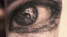 Realistic eye tattoos on arm