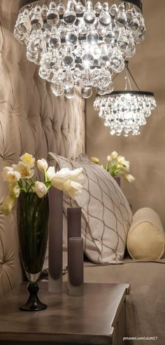 Gorgeous...Instead of the typical lamps on nightstands, how about these chandeliers by Ochre.