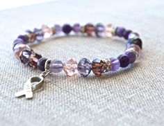 Support those fighting Lupus or Fibromyalgia with this HOPE bracelet. Created with beautiful Amethyst gemstones and faceted glass beads, this bracelet looks fabulous on its own or with a bracelet stac
