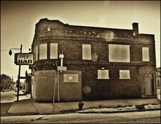 "This is the Apex Bar on Oakland Street in the Paradise Valley section of Detroit. It is a historic blues club where John Lee Hooker used to play when he came to Detroit. The inspiration for one his many hits ...""Boom Boom"" ....came from his time here. I read also that the bar has the distinction of being ""the cleanest bar in Detroit""!"