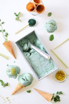 Lush, mossy green ice cream is infused with honey, kaffir lime, lemongrass, cilantro, and blue-green algae for an elegant and complex superfood ice cream! Recipe at www.kaleandcaramel.com.
