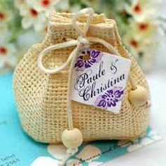 Fall wedding? This little burlap bag could hold a tulip or daffodil bulb favor. In the Spring, the flower will emerge to remind your guests that your love is still in bloom.