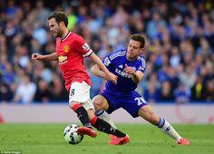 Manchester United midfielder Juan Mata (left) tries to escape from his compatriot Cesar Azpilicueta on his return to Stamford Bridge
