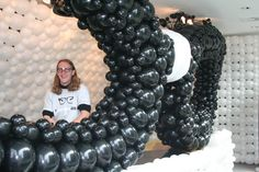 Digital agency Equator creates a giant pair of glasses made out of balloons with Guido Verhoef  (pictured) to celebrate its sponsorship of social media week Glasgow. #SocialMediaGeek