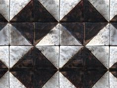 Hand-made industrial style square tile mosaic, decorated with black diagonal squares against a white background and fired in a raku kiln.