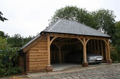 Red tiled oak car port with log store Shed Extension Ideas, Carport Sheds, Carport With Storage, Timber Garage, Wooden Castle, Landscape Curbing, Carport Designs, Log Home Designs, Carports
