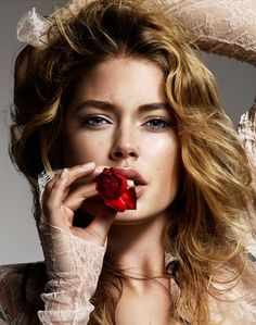 Doutzen Kroes.   (LARGE version of this is here:  http://www.theplace2.ru/archive/doutzen_kroes/img/doutzencoverelle20ja.jpg)