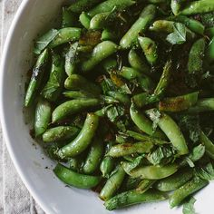 "Charred Snap Peas with Mint and Lemon--doesn't this say ""spring!"" all over it?  We'll have it with the mustard baked fish."
