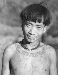 Chang Naga male with chest and facial tattoos, Ponyo, North West Burma / North East India. photo circa 1936.