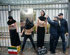 The FEMEN protested in front of the Iranian Embassy in Berlin against the execution of Reyhaneh Jabbari last Saturday . The girl was 26 years old and was sentenced to death for killing her rapist . FEMINISM IS NO SHAME , IS STRENGTH #Feminism #women #Feminist #sayes