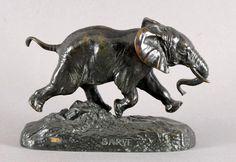 Vente le dimanche 28 février 2016 par Rennes Enchères à Rennes : BARYE Antoine Louis, 1796-1875 Eléphant du Sénégal bronze à patine brune, sur la terrasse : cachet à l or FB, BARYE et F. BARBEDIENNE FONDEUR Ht. : 14 cm Lg. : 21 cm. Est. 7 000 - 10 000 euros.