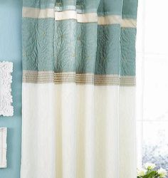 Quilted pin tuck curtains.