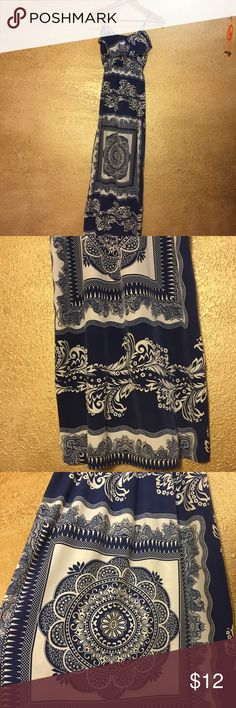 Blue and white boho paisley maxi dress So nice but I don't wear it enough. The straps were adjusted to fit me since I'm 5'2 it was long but they weren't cut so they can be altered. It's soft but not too flimsy. Feel like a dress shirt if that helps 100% polyester. Has one slit but not that high. NOT FREE PEOPLE. Tagged for visibility Free People Dresses Maxi