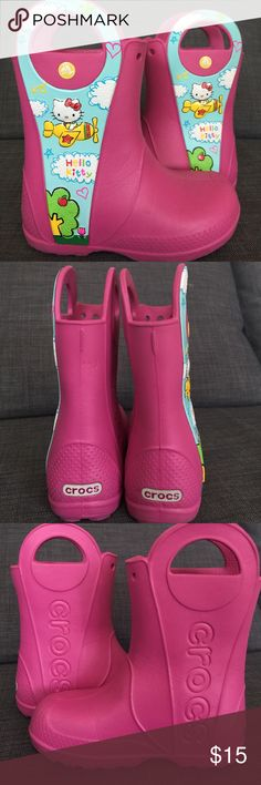 Gently Used Hello Kitty CROCS Rain boots Gently used and in excellent condition Hello Kitty CROCS rain boots in size 13Y.  My daughter outgrew these before she could really put them to good use. They most definitely still have a ton of life left in them. They are super light and do a great job at keeping your littles feet nice and dry and dirt free. CROCS Shoes Rain & Snow Boots