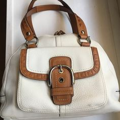 """Coach Domed Satchel Shoulder Bag This listing is for a Coach, white leather bag with tan trims. Measurements 12 x 5.5 x 14.5"""". Strap drop is approx 8"""".  This is a large bag with double top zipper pull, exterior buckle flap pocket. Great condition with a small smudge by bottom of buckle. No tears or major stains.  All offers are welcome.  Thank you Coach Bags Shoulder Bags"""