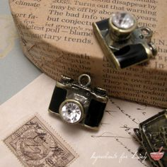 1 Pc Camera Charm Antique Bronze Charm Diamond Jewel Lens Camera Charm Pendant Black Resin Vintage Style Pendant Charm Jewelry Supplies. $3.99, via Etsy.