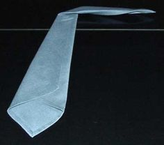 6. Fold the upper 1/3 of the tie diagonally to the right so the tip of the tie is perpendicular to he lower part.