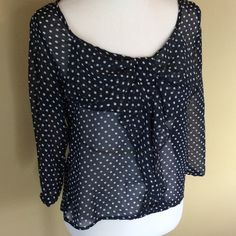 Navy and white polka dot top Navy and white sheer polka dot top with bow detail on the chest. There is no tag for the brand. 100% polyester Tops Blouses