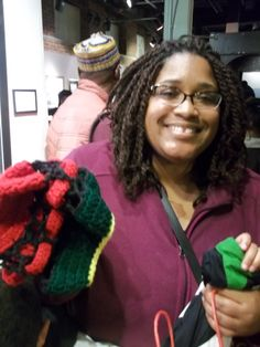 I love your smile, dear.  Beautiful personality with a young boy in tow.  Can't let go of his hand now.  Teehee  #crochet #hat #kwanzaa #rasta AWESOME CROCHET BY GINA RENAY