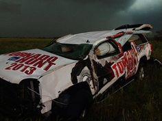 "The Tornado Hunt vehicle after being thrown nearly 200 yards by the El Reno Tornado in Oklahoma City tonight. Tornado Hunt crew and Mike Bettes are okay! Photo Credit: @SeanSchoferTVN Sean Schofer at 8:25pm. ""We stopped to help & they are OK,"" said Schofer."