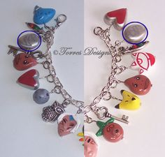 Legend of Zelda Majora's Mask charm  bracelet featuring all the masks in the game. I really want this.!