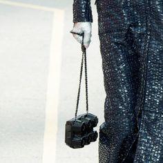 Chanel Supermarket / Chanel Shopping Center / Supermarche. Paris Fashion Week 2014. Grand Palais. Model holding a black faux egg carton purse