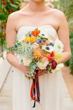 anemone, thistle, and pincushion bouquet, photo by Sweet Little Photographs http://ruffledblog.com/modern-palm-springs-wedding #flowers #weddingbouquet