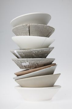 stephanie sommet,  This double cast bowl pile represent Paris by its materials: from top to bottom: Porcelain, concrete, wax, concrete x2, red concrete, concrete x2, plaster of Paris.