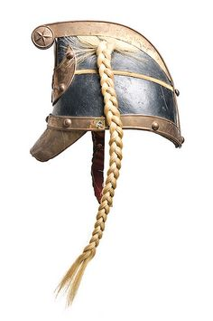 Charleston Light Dragoons helmet, c. 1893. Worn by William Lowndes (Charleston, 1872-1964), son of Richard D. I'on Lowndes & Alice Izard Middleton. The helmet has the palmetto and South Carolina seal on the front crescent. The horsehair braid is typical for mounted units (dragoons). Charleston Museum.