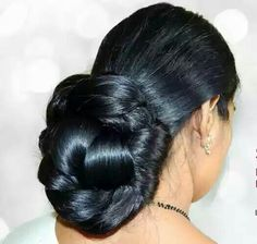 What a beautiful large braided low bun! Care however should be taken before adopting such hairstyles, as due to it's high static charge, it will cause phlegm to move up in the throat, causing the voice to quaver & a frequent urge to clear the throat. A heavy chabi chhalla with a long & wide hook if inserted at the edge of the pleats of the saree, will reduce this problem as it's hook will activate the acupressure points that act to keep the throat clear.