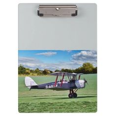 """Black Bi Plane clipboard idea gift for the aviation enthusiast Excellent for note-taking and organizing important papers, these  ultra-sturdy acrylic clipboards will keep you on track and in style. Dimensions:  12.5""""l x 9""""w #aircraft"""