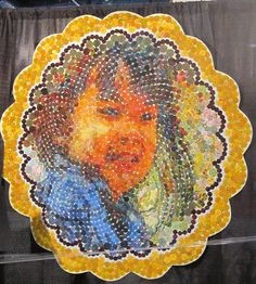 'Grace' by Shin-hee Chin of McPherson, Kansas. ~ This amazing quilt art is made up entirely of hand stitched yo-yo's!