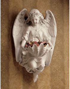 When we heard that an antiques dealer had rescued this angel from a crumbling abbey, we knew we had an obligation to keep its classic beauty alive. An example of Victorian sculpture, this nearly 1½-foot-tall antique replica wall angel holds a shell font cast in quality designer resin. A exclusive for home or garden.