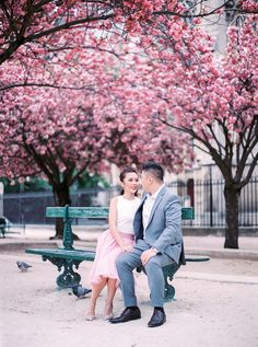 """""""I love Paris in the spring time"""" goes the opening line of Sinatra's timeless song about this eternally-romantic city, and so do we! Timothy and Florence's pastel-painted pre-wedding shots, by film photographer Le Secret D'Audrey, inspire us to traipse through Paris on our very own spring time strolls. Just look at those magnificent bursts of pink cherry blossoms!"""