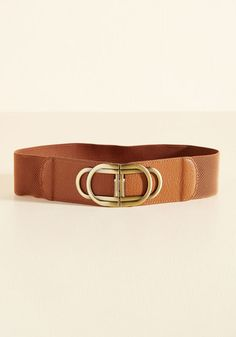 Call upon this tan belt to polish your ensemble in seconds flat! A figure-highlighting accessory with endless potential, this classy piece offers a clasp of golden rings and faux-leather accents to satisfy your need for a fab finishing touch.