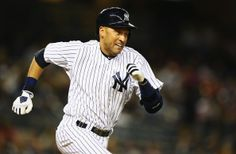 Derek Jeter #2 of the New York Yankees hits a single against the Boston Red Sox during their game at Yankee Stadium on April 11, 2014 in the...