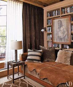 Native American Vintage Photo, wood, natural hide leather sofa cover; and of course the books! The browns and whites make it all so peaceful.