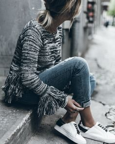A fringed knit sweater + spring knitwear trend+ ultra alternative, + fray detailing at the sleeves and + snazzy overall style + Jacqueline Mikuta.  Brands not specified.