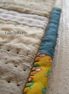 zakka binding... ***love the mixture of fabrics on the binding and visible stitching!.