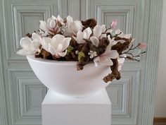 Centerpiece of natural branches and silk Magnolias in large white bowl