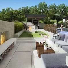 Low concrete fireplace on concrete patio