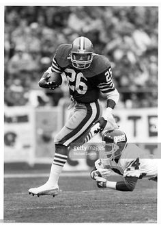 Running back Wendell Tyler #26 of the San Francisco 49ers carries the ball against cornerback Kenny Daniel #24 of the New York Giants during the 1984 NFC Divisional Playoff Game at Candlestick Park .