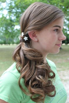 side pony tail with lots of curls   Hair by Liz Perniciaro
