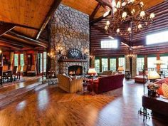 Massive amount of space in this log home - gorgeous, but way too big for one family! #LogHomeDecorating