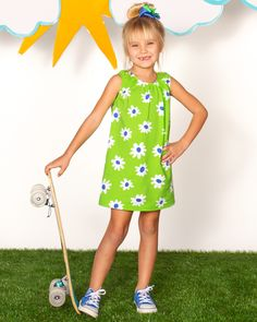 She will look darling in this easy peasy bright green daisy knit dress!