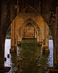 Under the Siuslaw River Bridge in Florence, Oregon...captured with the sun reflecting off the water and arches!