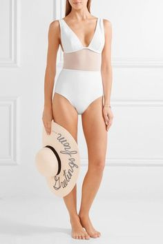 White stretch nylon and mesh Pull on 72% nylon, 28% elastane; panel: 94% nylon, 6% elastane; lining: 90% polyamide, 10% elastane Hand wash Lotion, sunscreen, oil and chlorine can cause discoloration of this item; this is not a manufacturing defect. Please follow care instructions to keep your swimwear in the best condition Imported