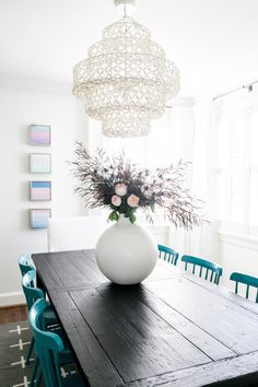 All white dining room with pops of teal: http://www.stylemepretty.com/living/2016/11/25/the-5-reasons-you-should-be-designing-with-white/ Photography: Catherine Truman - http://www.catherinetrumanphoto.com/