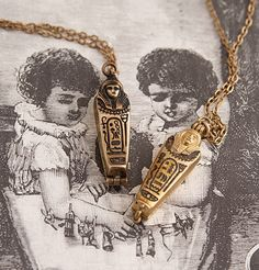 WOW. 1920s Sarcophagus with Mummy Necklaces from Erica Weiner.